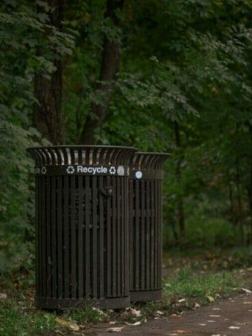 black wooden trash bin on green grass field